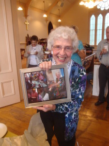Our energetic summer music director, Marg Small shows off photos of the hymn sing.
