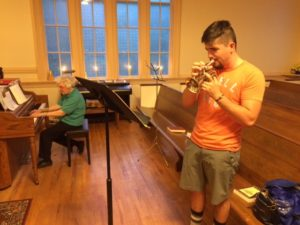 Stowe Duston practices with Marg Small on the French Pocket Trumpet for Sunday morning's music.